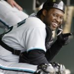 SAN FRANCISCO - MAY 19:  Catcher Charles Johnson #23 of the Florida Marlins smiles in the dugout with his equipment on during the MLB game against the San Francisco Giants at Pacific Bell Park in San Francisco, California on May 15, 2002. The Marlins won 4-2.  (Photo by Jed Jacobsohn/Getty Images)